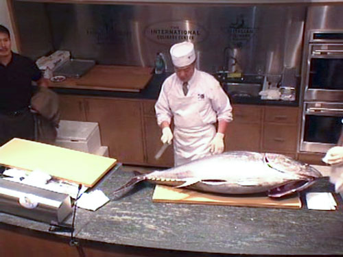 Chef Suzuki with a whole Kindai Bluefin Tuna. It weighs about 60 kilos and costs about 72 dollars a kilo.