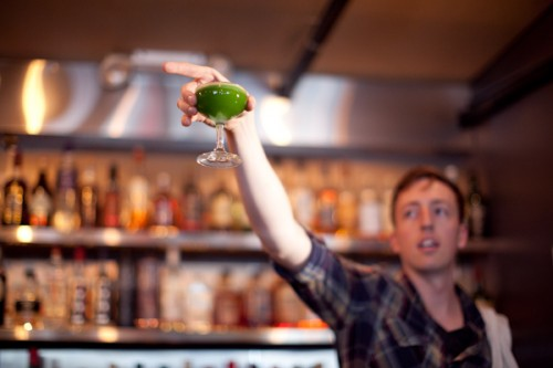 Bar manager Tristan shows off the greenness of the Bangkok Daiquiri. Pretty photo by Shannon Sturgis for StarChefs